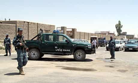 Afghan police patrol in Lashkar Gah