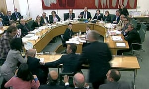 A young man in a checked shirt launches an attack on Rupert Murdoch at the select committee