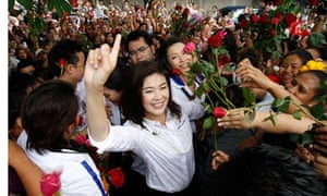 Puea Thai Party's Yingluck Shinawatra greets supporters