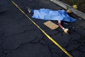 24 hours in pictures: The corpse of an murder victim lies in the street in Guatemala City