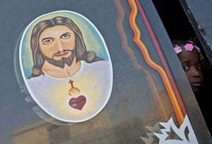24 hours in pictures: An image of Jesus Christ adorns a bus window in Haiti