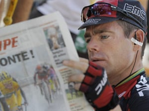 Tour de France stage 17: Cadel Evans peruses L'Equipe before the start of stage 17