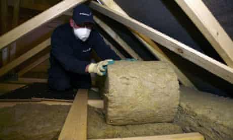 A British Gas engineer insulating a customer's loft