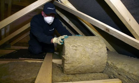 A British Gas engineer insulating a customer's loft