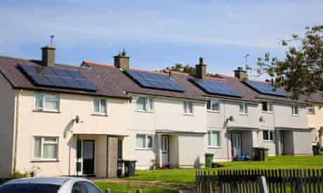 Row of terraced houses with solar panels