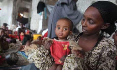 Somali woman holds child