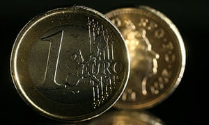 euro and pound coin