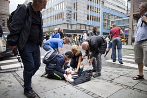 Oslo bombing: People tend to a wounded person
