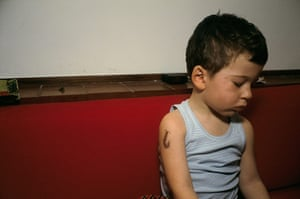 Nan Goldin:  Bruno with a fake tattoo on his arm by Nan Goldin