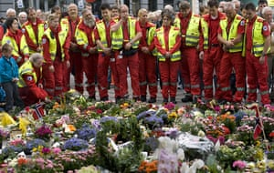 Norway attacks aftermath: paramedics place flowers