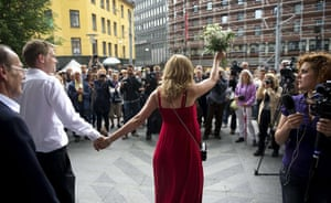 Norway attacks aftermath: A newly wed couple walks out into the media scrum