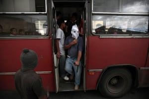 FTA: Jorge Dan Lopez: Armed villagers check a public bus entering their village of Castanas