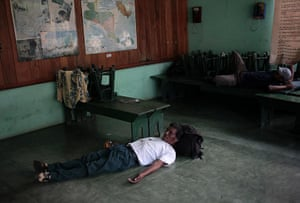 FTA: Jorge Dan Lopez: Men from Honduras rest in a Casa del Migrante (Migrant House)