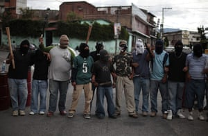 FTA: Jorge Dan Lopez: Armed villagers pose at the entrance to their village of Castanas