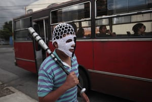 FTA: Jorge Dan Lopez: An armed villager guards the entrance to the village of Castanas