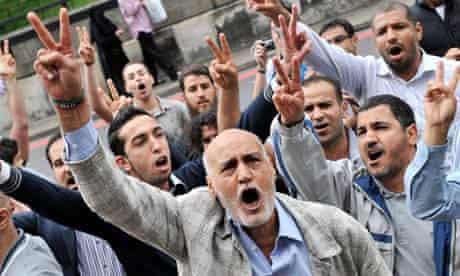 Anti-Gaddafi protesters outside the Libyan embassy