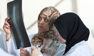 Nurses at hospital in besieged Libyan rebel city of Misrata examine X-ray of wounded fighter