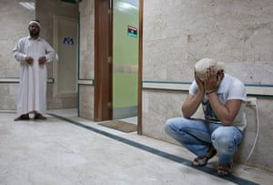 Misrata hospital: A rebel fighter learns of the death of a comrade