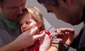 A baby is given a flu jab