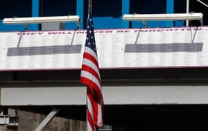 September 11 Memorial: A U.S. flag is seen near a sign with names of those lost