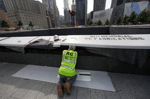 September 11 Memorial: A worker at the North pool waterfall area as work continue