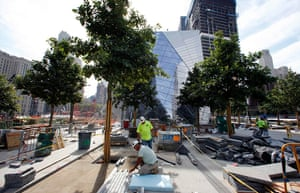 September 11 Memorial: Workers install stone and pavers on the main plaza area