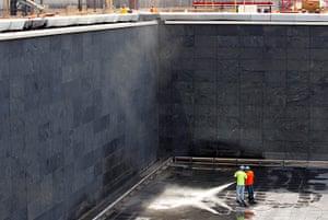 September 11 Memorial: Workers pressure clean inside the North pool waterfall