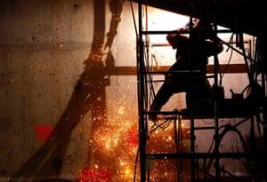 September 11 Memorial: A welder works below ground level