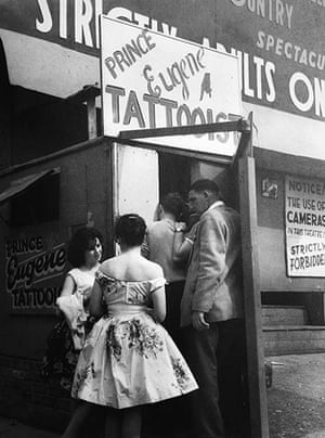 Blackpool: People gather outside a tattooist's