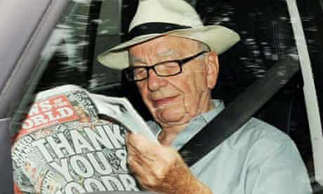 Rupert Murdoch reading the last edition of the News of the World
