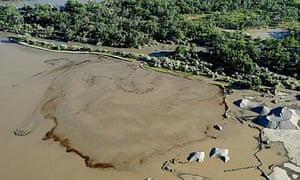 Oil swirls in the Yellowstone river after an Exxon Mobil pipeline ruptured near Billings, Montana