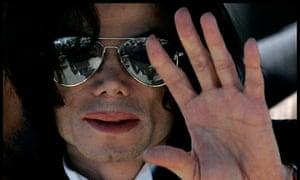 Michael Jackson waves as he leaves the Santa Barbara County Courthouse