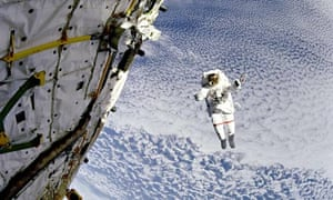Astronaut Mark Lee floats outside Discovery, 149 miles above the Earth, 1994.