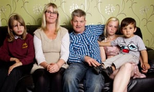 Young grandmother Jayne Fox with her family at home in Rotherham.