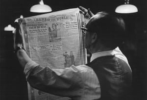 News of The World History: A printer studies a front page proof at the News of The World