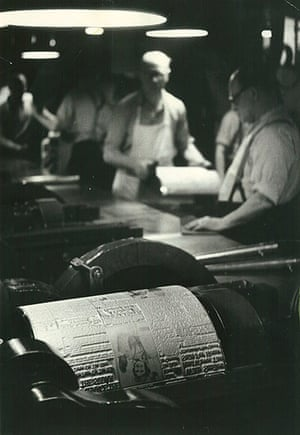 News of The World History: Operators at work in the foundry remove plates from the Autoplate machine