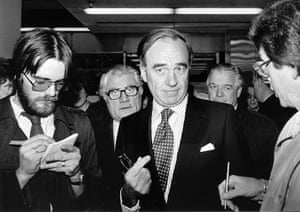 News of The World History: Rupert Murdoch, centre, about to become the new owner of Times Newspapers
