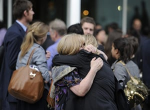 News of The World History: Two members of The News of The World staff hug outside a pub
