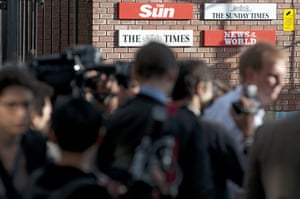 News of the World Update: Press gather outside the News of the world offices in Wapping