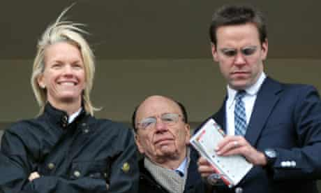 News Corporation CEO Rupert Murdoch flanked by his daughter Elisabeth and son James