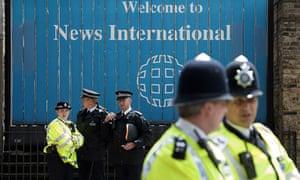 Policemen outside News International
