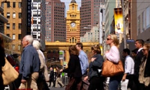 Office workers crossing street in downtown Melbourne