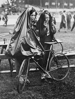 Herne Hill Velodrome:  Young Women Cycling In The Rain