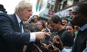 Boris Johnson talks to residents of Clapham Junction after the area was hit by rioting