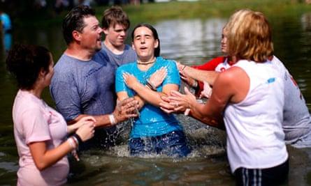 girl baptized at Creation Christian music festival, Pennsylvania US