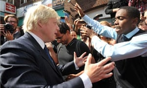 Boris Johnson on a walkabout of the devastation in riot-hit Clapham Junction