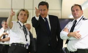 David Cameron with police