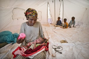 Dadaab camp, Kenya: Mother with her new born in new tent  Dadaab camp, Kenya