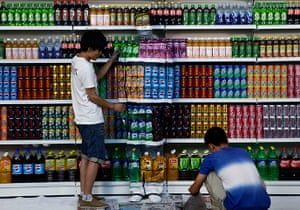 24 hours in pictures: Chinese artist Liu Bolin is painted as row of drinks