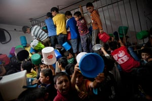 24 hours in pictures: Palestinian children struggle to get a ration of donated food, West Bank
